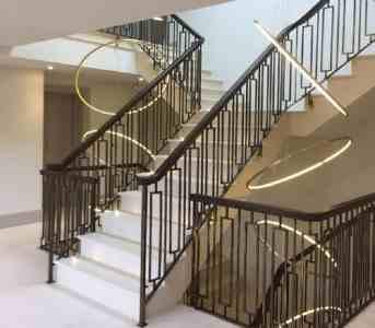 Ornate-steel-balustrade-wood-handrail